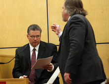Steve Griffin | The Salt Lake Tribune   West Valley City Police officer Todd Gray looks at evidence from the witness stand, during the voyeurism trial for Steve Powell, the father-in-law of missing Utah woman Susan Powell, in Pierce County Superior Court  in Tacoma, Wash., on Monday May 14, 2012.