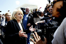 Arizona Gov. Jan Brewer speaks to reporters outside the Supreme Court in Washington, Wednesday, April 25, 2012, after the court's hearing on Arizona's