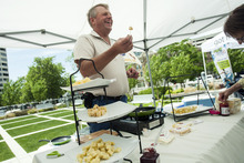 Chris Detrick  |  The Salt Lake Tribune Grant Kohler, of Heber Valley Artisan Cheese, gives out samples of his Juustoleipa cheese during a public celebration at the Federal Building commemorating the 150th anniversary of the United States Department of Agriculture Tuesday May 15, 2012. The USDA was established May 15, 1862 by President Abraham Lincoln
