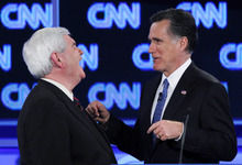 FILE - In this Jan. 26, 2012 file photo, Republican presidential candidates, former House Speaker Newt Gingrich and former Massachusetts Gov. Mitt Romney talk during a commercial break at the Republican presidential candidates debate in Jacksonville, Fla. Remember Gingrich calling Romney a liar? Michele Bachmann saying Romney's unelectable? Rick Santorum calling Romney