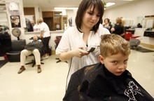 Rick Egan    The Salt Lake Tribune   Kiana Perez cuts 4-year-old Brock Wunderly's hair, as part of the cosmetology program at the Redwood Campus of the Salt Lake Community College, Wednesday, April 11, 2012.  The Salt Lake Community College Board of Trustees voted Wednesday to discontinue the school's barbering and cosmetology program.