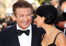 Actor Alec Baldwin, left, and Hilaria Thomas arrive for the opening ceremony and screening of Moonrise Kingdom at the 65th international film festival, in Cannes, southern France, Wednesday, May 16, 2012. (AP Photo/Joel Ryan)