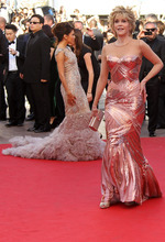 Actors Jane Fonda, right, and Eva Longoria at back arrive for the opening ceremony and screening of Moonrise Kingdom at the 65th international film festival, in Cannes, southern France, Wednesday, May 16, 2012. (AP Photo/Joel Ryan)