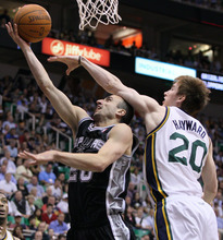 Utah Jazz guard Gordon Hayward (20) attempts to block the shot of San Antonio Spurs guard Manu Ginobili (20) of Argentina during the first half of Game 4 in the first-round NBA basketball playoff series, Monday, May 7, 2012, in Salt Lake City. (AP Photo/Colin E Braley)