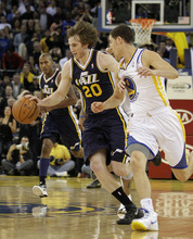 Utah Jazz's Gordon Hayward (20) drives past Golden State Warriors' Klay Thompson during the second half of an NBA basketball game Saturday, Jan. 7, 2012, in Oakland, Calif. (AP Photo/Ben Margot)