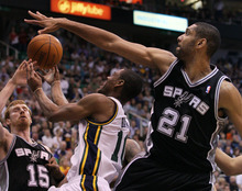 Utah Jazz guard Alec Burks, center attempts to score against San Antonio Spurs center Tim Duncan (21) and power forward Matt Bonner (15) during the second half of Game 3 in the first-round NBA basketball playoff series, Saturday, May 5, 2012, in Salt Lake City. The Spurs defeated the Jazz 102-90 to lead the series 3-0. (AP Photo/Colin E Braley)
