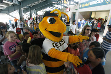 Francisco Kjolseth  |  The Salt Lake Tribune Bumble the Bee is surrounded by kids as the Salt Lake Bees host the Albuquerque Isotopes on Tuesday, May 15, 2012, as baseball tries to grow the next generation of fans through things like Tuesday's annual school day game at Spring Mobile Ballpark.