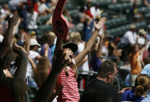 Francisco Kjolseth  |  The Salt Lake Tribune Sydney Trimble, 11, of J.A. Taylor Elementary in Centerville gets into the spirit of singing the YMCA song during the Salt Lake Bees hosing of the Albuquerque Isotopes on Tuesday, May 15, 2012, as baseball tries to grow the next generation of fans through things like Tuesday's annual school day game at Spring Mobile Ballpark.