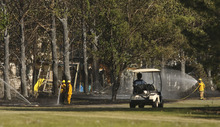 Leah Hogsten     The Salt Lake Tribune South Jordan firefighters battle a  brush fire that started near Glenmoor Golf Course on Tuesday, May 15, 2012, in South Jordan. The fire, which heavily damaged one home and led to the evacuation of nearly two dozen others, remained under investigation Wednesday.