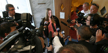 Steve Griffin/The Salt Lake Tribune   An emotional Alina Powell talks to the media following her father, Steve Powell's, trail in the Pierce County Superior Court in Tacoma, Washington Wednesday May 16, 2012. Steve Powell was found guilty on all 14 counts of voyeurism.