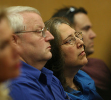 Steve Griffin/The Salt Lake Tribune   Judy Cox, center, and Chuck Cox, listen as Judge Ronald E. Culpepper reads the verdict in the Steve Powell voyeurism trail in the Pierce County Superior Court in Tacoma, Washington Wednesday May 16, 2012. Powell was found guilty on 14 counts of voyeurism.