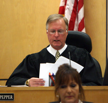 Steve Griffin/The Salt Lake Tribune   Judge Ronald E. Culpepper reads the verdict in the Steve Powell trial  in the Pierce County Superior Court in Tacoma, Washington Wednesday May 16, 2012. Powell was found guilty on 14 counts of voyeurism.