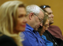 Steve Griffin/The Salt Lake Tribune   Judy Cox, center, and Chuck Cox, lower their heads as they listen as Judge Ronald E. Culpepper reads the verdict in the Steve Powell voyeurism trail in the Pierce County Superior Court in Tacoma, Washington Wednesday May 16, 2012. Powell was found guilty on 14 counts of voyeurism.