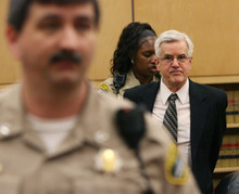 Steve Griffin/The Salt Lake Tribune   Steve Powell is led out of Judge Ronald E. Culpepper's courtroom after being found guilty of 14 counts of voyeurism in the Pierce County Superior Court in Tacoma, Washington Wednesday May 16, 2012.