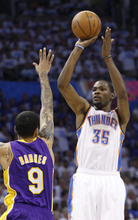 Oklahoma City Thunder forward Kevin Durant (35) shoots over Los Angeles Lakers forward Matt Barnes (9) in the third quarter in Game 2 of an NBA basketball playoffs Western Conference semifinal, in Oklahoma City on Wednesday, May 16, 2012. (AP Photo/Sue Ogrocki)