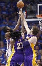 Oklahoma City Thunder guard James Harden, left, shoots as Los Angeles Lakers center Jordan Hill (27) and forward Pau Gasol, right, defend, in the first quarter in Game 2 of an NBA basketball playoffs Western Conference semifinal, in Oklahoma City on Wednesday, May 16, 2012. (AP Photo/Sue Ogrocki)