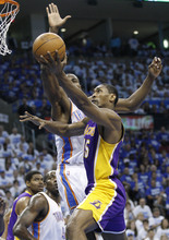 Los Angeles Lakers forward Metta World Peace, right, shoots in front of Oklahoma City Thunder forward Serge Ibaka during the first quarter in Game 2 of an NBA basketball playoffs Western Conference semifinal, in Oklahoma City on Wednesday, May 16, 2012. (AP Photo/Sue Ogrocki)