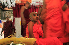 Pasindu, a twelve-year-old Sri Lankan boy, looks on after he was ordained as Buddhist monk Matale Sasanaratana at a temple in Colombo, Sri Lanka,Thursday, May 17, 2012. Buddhism is Sri Lanka's state religion but its age old tradition of youngsters being ordained is on the decline largely due to economic reasons. (AP Photo/Eranga Jayawardena)