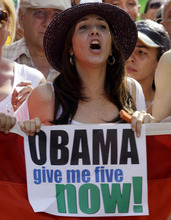 Mariela Castro, daughter of Cuba's President Raul Castro, holds a sign demanding President Barack Obama release five Cuban intelligence agents imprisoned in U.S., popularly known as the