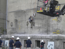 An Air Force soldier ascended an Ohio cement silo last month using a device designed and built by USU engineering students for the Air Force Research Laboratory's annual design competition.  The USU equipment, called the Personnel Vacuum Assisted Climber, or PVAC, won the event.  Courtesy Utah State University