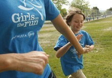 Leah Hogsten  |  The Salt Lake Tribune Mentor Emeliee Dirks (left) congratulates student Lizzy Blackwell for her efforts while running around Morningside Elementary's playground.  Morningside Elementary 3rd -6th grade girls run into shape after school for a 5k run with the guidance of  trained coaches that mentor the girls Wednesday, May 16 2012 in Salt Lake City..  Girls on the Run is a national non-profit in 43 states. The 12-week program concludes with all participants walking or running in a 5K (3.1 mile) event.