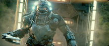 In this film publicity image released by Universal Pictures, an alien invader attacks in a scene from