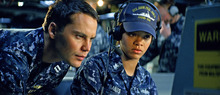 In this film publicity image released by Universal Pictures, Taylor Kitsch, left, and Rihanna are shown in a scene from