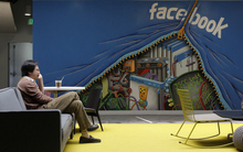 A worker sits in the Facebook office in Menlo Park, Calif., Friday, May 11, 2012.  The company Mark Zuckerberg created as a Harvard student eight years ago is preparing for what looks to be the biggest Internet IPO ever.  (AP Photo/Jeff Chiu)
