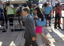 Former presidential candidate and Sen. John Edwards and his daughter Cate Edwards arrive at the federal courthouse in Greensboro, N.C., Thursday, May 17, 2012. Edwards has pleaded not guilty to six counts related to campaign finance violations over nearly $1 million from two wealthy donors used to help hide the Democrat's pregnant mistress as he sought the White House in 2008. (AP Photo/Gerry Broome)
