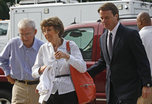 Former presidential candidate and Sen. John Edwards, right, arrives at a federal courthouse with his parents Wallace and Bobbie Edwards in Greensboro, N.C., Wednesday, May 16, 2012. Edwards has pleaded not guilty to six counts related to campaign finance violations over nearly $1 million from two wealthy donors used to help hide the Democrat's pregnant mistress as he sought the White House in 2008. (AP Photo/Chuck Burton)