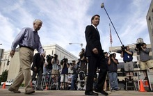 Former presidential candidate and Sen. John Edwards, right, arrives at a federal courthouse with his father Wallace Edwards in Greensboro, N.C., Wednesday, May 16, 2012.  Edwards has pleaded not guilty to six counts related to campaign finance violations over nearly $1 million from two wealthy donors used to help hide the Democrat's pregnant mistress as he sought the White House in 2008. (AP Photo/Chuck Burton)(AP Photo/Gerry Broome)