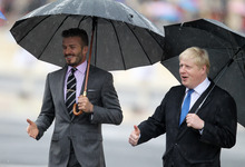 Former England football captain David Beckham, left, and London Mayor Boris Johnson attend a handover for the Olympic flame at Panathenaean stadium in Athens, Thursday, May 17, 2012.  The torch begins its 70-day journey to arrive at the opening ceremony of the London 2012 Olympics, from the Greek capital, to cover about 8,000-mile (12,875-kilometer) on its progress over many parts of England to start the games. (AP Photo/Thanassis Stavrakis)