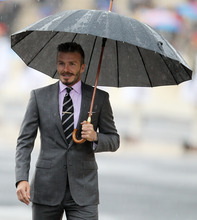 Former England football captain David Beckham attends a hand over Olympic Flame ceremony at the Panathenaean stadium in Athens, Thursday, May 17, 2012 . The torch begins its 70-day journey to arrive at the opening ceremony of the London 2012 Olympics, from the Greek capital, to cover about 8,000-mile (12,875-kilometer) on its progress over many parts of England to start the games. (AP Photo/Thanassis Stavrakis)