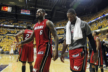 Miami Heat's LeBron James (6) and Dwyane Wade, right, leave the court after losing 94-75 to the Indiana Pacers in Game 3 of their NBA basketball Eastern Conference semifinal playoff series, Thursday, May 17, 2012, in Indianapolis.  (AP Photo/Darron Cummings)