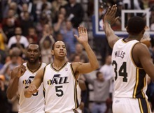 Trent Nelson  |  The Salt Lake Tribune Utah Jazz guard Devin Harris (5) high-fives Utah Jazz guard/forward C.J. Miles (34) after hitting the go-ahead basket to win the game. Utah Jazz vs. Miami Heat, NBA basketball at EnergySolutions Arena Friday, March 2, 2012 in Salt Lake City, Utah. Utah Jazz center/forward Al Jefferson (25) at left.