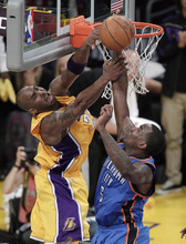 Los Angeles Lakers' Kobe Bryant, left, gets his shot blocked by Oklahoma City Thunder's Kendrick Perkins during the first half in Game 4 of an NBA basketball playoffs Western Conference semifinal in Los Angeles, Saturday, May 19, 2012. (AP Photo/Jae C. Hong)