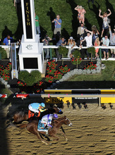 I'll Have Another, bottom, ridden by Mario Gutierrez, crosses the finish line ahead of Bodemeister, ridden by Mike Smith, to win the 137th Preakness Stakes horse race at Pimlico Race Course, Saturday, May 19, 2012, in Baltimore. (AP Photo/Nick Wass)