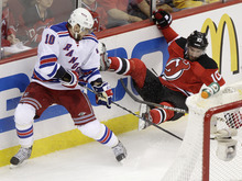 New York Rangers right wing Marian Gaborik, left, of Slovakia, left, collides with New Jersey Devils defenseman Peter Harrold during the first period of Game 3 of an NHL hockey Stanley Cup Eastern Conference final playoff series, Saturday, May 19, 2012, in Newark, N.J.  (AP Photo/Frank Franklin II)