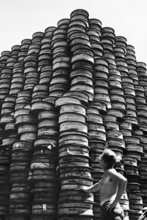 Cpl. Charles H. Faulkner of Salt Lake City, Utah, checks over a ?mountainous? pile of rolled communication wire ?somewhere in Korea?  Sept. 1, 1950 (AP Photo)