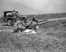 Three GIs take a breather for a welcome mail call near the front lines in the Han River sector of South Korea on Sept. 29, 1950. From left are: Cpl. James Franchow, 1107 South Seven, East Salt lake City; M/Sgt. Edward S. Plucinsky, 3824 Acorn St. Pittsburgh, Pa.; and Sgt. Neil Elliott, of Wilmington, Calif. (AP Photo/Frank Noel)