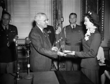 President Harry Truman on Jan. 9, 1951 presents to Mrs. Lavon P. Henry of Salt Lake City, Utah, a congressional medal of honor awarded to her husband, First Lieut. Frederick F. Henry, a native of Clinton, Okla., who is missing in action in Korea. Brig. Gen. Robert Landry, White House air force aide, stands in center background. (AP Photo/Henry Griffin)