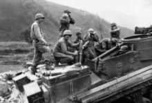 Members of a United Nations howitzer team fire into enemy position in Korea on June 4, 1951. In group (left to right) are: Pfc. Rex Richmond, Bremerton, Wash; Pfc. Walter Ormbrek, Seattle, Wash.; Pfc. Vincent Troliano (standing, rear), Baltimore, Md.; Sgt. Edward Lavitt and Sgt. Parley Lang, both of St. George, Utah; and Pfc. David Paxman, Washington, Utah. (AP Photo)