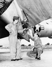 Air forces officers at base on Okinawa inspect damage to wing flap of B-29 which returned safely from Korean mission despite attack by Russian-built MIG fighter on June 9, 1951. The big ship sustained these lacerations in the flap but came home safely. At left is Capt. Donald M. Covic, 343 Chadron Ave., Chadron, Nebr.,and Lt. David P. Self, pilot, of 509 S. 17th St., Salt Lake City, Utah. (AP Photo)