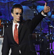 FILE - In this May 15, 2007, file photo, The Bee Gees' Robin Gibb salutes the crowd after The Bee Gees were named BMI Icons during the 55th Annual BMI Pop Awards in Beverly Hills, Calif. A representative said on Sunday, May 20, 2012, that Gibb has died at the age of 62. (AP Photo/Chris Pizzello, File)