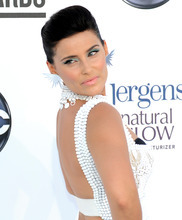 In this photo provided by the Las Vegas News Bureau, Canadian singer-songwriter Nelly Furtado walks the red for the 2012 Billboard Music Awards at the MGM Grand on the Las Vegas Strip. Sunday, May 20, 2012. (AP Photo/Las Vegas News Bureau, Glenn Pinkerton)