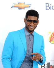 In this photo provided by the Las Vegas News Bureau, singer/songwriter Usher walks the red carpet for the 2012 Billboard Music Awards at the MGM Grand on the Las Vegas Strip. Sunday, May 20, 2012. (AP Photo/Las Vegas News Bureau, Glenn Pinkerton)