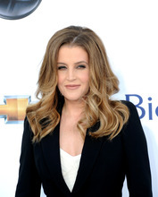 In this photo provided by the Las Vegas News Bureau, Lisa Marie Presley walks the red carpet for the 2012 Billboard Music Awards at the MGM Grand on the Las Vegas Strip. Sunday, May 20, 2012. (AP Photo/Las Vegas News Bureau, Glenn Pinkerton)