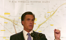 FILE - In this July 14, 2006, file photo, Massachusetts Gov. Mitt Romney uses a map of the Big Dig tunnels to make a point about potential trouble spots during an afternoon briefing in Boston. Romney was at his New Hampshire vacation home on a summer night in 2006 when tons of concrete ceiling panels in one of Boston's Big Dig highway tunnels collapsed. The debris crushed a car and killed a female passenger. Romney, then in his final year as Massachusetts governor, dashed back to Boston and immersed himself in the crisis. His response offers insights into what kind of leader the expected Republican nominee would be if elected president. Romney has made his management skills a major selling point in his campaign. (AP Photo/Celina Fang)