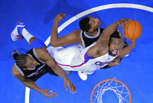 Los Angeles Clippers center DeAndre Jordan, right, grabs a rebound away from San Antonio Spurs forward Kawhi Leonard, left, and forward Boris Diaw of France during the first half in Game 4 of an NBA basketball playoffs Western Conference semifinal, Sunday, May 20, 2012, in Los Angeles. (AP Photo/Mark J. Terrill)