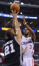 Los Angeles Clippers guard Chris Paul, right, puts up a shot as San Antonio Spurs center Tim Duncan defends during the first half in Game 4 of an NBA basketball playoffs Western Conference semifinal, Sunday, May 20, 2012, in Los Angeles. (AP Photo/Mark J. Terrill)
